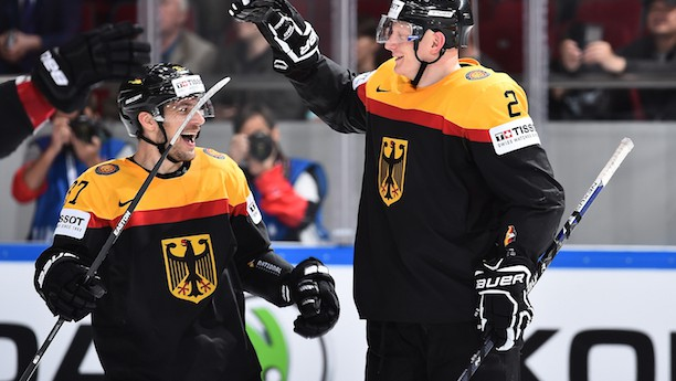 ST. PETERSBURG, RUSSIA - MAY 16: Germany's Denis Reul #2 celebrates with Patrick Reimer #37 after scoring a third period goal during preliminary round action at the 2016 IIHF Ice Hockey World Championship. (Photo by Minas Panagiotakis/HHOF-IIHF Images)