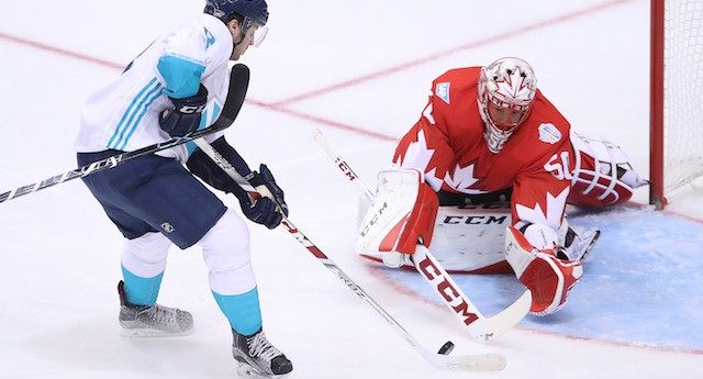 TORONTO, ON - SEPTEMBER 21: Corey Crawford #50 of Team Canada stops Tobias Rieder #8 of Team Europe on a breakaway during the World Cup of Hockey tournament at the Air Canada Centre on September 21, 2016 in Toronto, Canada. (Photo by Tom Szczerbowski/Getty Images)