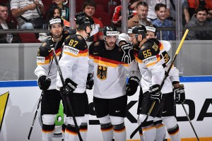 ST. PETERSBURG, RUSSIA - MAY 7: Germany's Tobias Rieder #8 celebrates with Daryl Boyle #7, Philip Gogulla #87, Felix Schutz #55 and Patrick Hager #50 after scoring Team Germany's first goal of the game during preliminary round action at the 2016 IIHF Ice Hockey Championship. (Photo by Minas Panagiotakis/HHOF-IIHF Images)