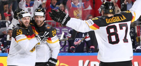 COLOGNE, GERMANY - MAY 5: Germany's Felix Schutz #55, Dennis Seidenberg #24 and Philip Gogulla #87 celebrate after a third period goal against the U.S. during preliminary round action at the 2017 IIHF Ice Hockey World Championship. (Photo by Andre Ringuette/HHOF-IIHF Images)