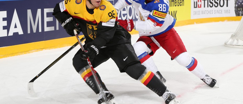 COLOGNE, GERMANY - MAY 8: Germany's Frederik Tiffels #95 plays the puck while Russia's Nikita Kucherov #86 defends during  preliminary round action at the 2017 IIHF Ice Hockey World Championship. (Photo by Andre Ringuette/HHOF-IIHF Images)
