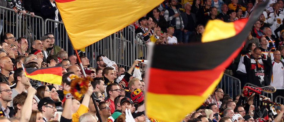 COLOGNE, GERMANY - MAY 10: Germany fans waving their flags and cheering on their team during preliminary round action against Slovakia at the 2017 IIHF Ice Hockey World Championship. (Photo by Andre Ringuette/HHOF-IIHF Images)