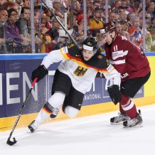 COLOGNE, GERMANY - MAY 16: Germany's Leon Draisaitl #29 plays the puck while fending off Latvia's Kristaps Sotnieks #11 during preliminary round action at the 2017 IIHF Ice Hockey World Championship. (Photo by Andre Ringuette/HHOF-IIHF Images)